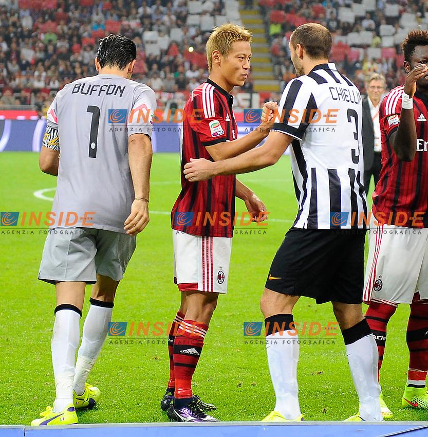 Keisuke Honda Milan, Giorgio Chiellini Juventus<br /> Milano 20-09-2014 Stadio Giuseppe Meazza - Football Calcio Serie A Milan - Juventus. Foto Giuseppe Celeste / Insidefoto