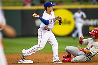 Round Rock Express second baseman Thomas Field (2) turns a double play as Memphis Redbirds baserunner Greg Garcia (5) slides into second base during Pacific Coast League game on April 21, 2015 at the Dell Diamond in Round Rock, Texas. Round Rock defeated Memphis 2-1. (Andrew Woolley/Four Seam Images)