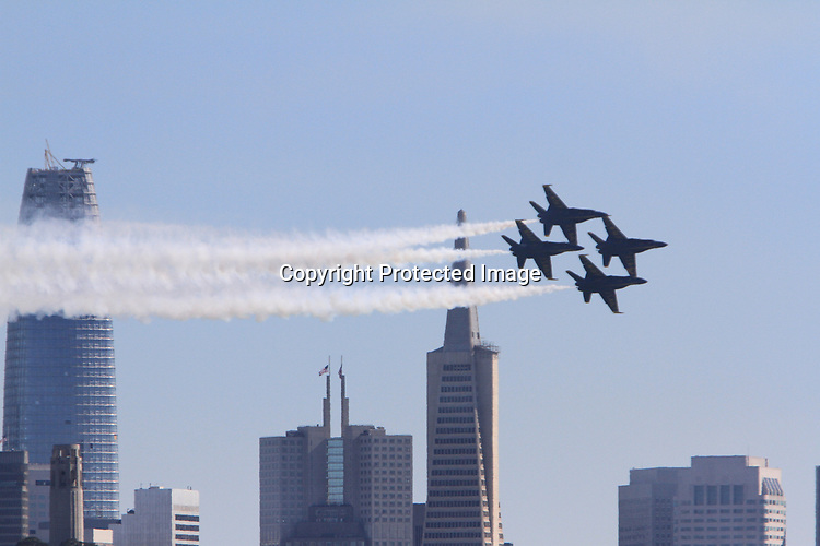 The Navy Blue Angel fly over the Bay Area during Fleet Week in San Francisco, CA.