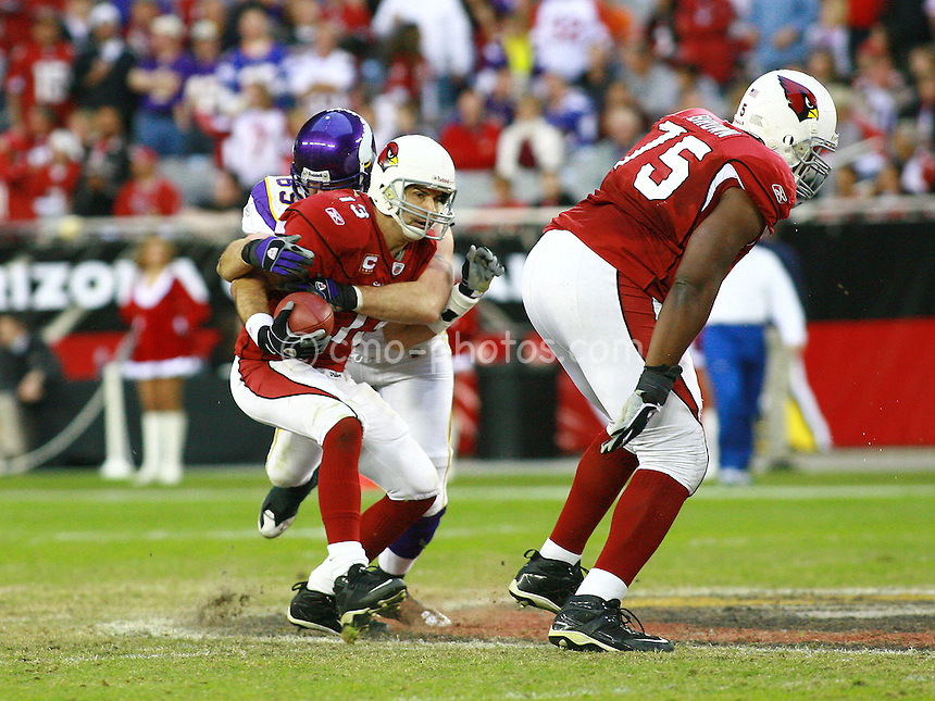 Dec 07, 2008; Glendale, AZ, USA; Arizona Cardinals quarterback Kurt Warner (13) is sacked by Minnesota Vikings defensive end Jared Allen (69) as offensive tackle Levi Brown (75) stands by in the fourth quarter of a game at University of Phoenix Stadium.  The Vikings won the game 35-14.