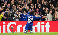 Willian of Chelsea slides to celebrate his goal in front of supporters during the UEFA Champions League Group G match between Chelsea and Dynamo Kyiv at Stamford Bridge, London, England on 4 November 2015. Photo by Andy Rowland.