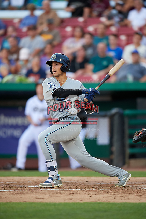 West Michigan Whitecaps designated hitter Dylan Rosa (24) hits a single and drives in a run during a game against the Kane County Cougars on July 19, 2018 at Northwestern Medicine Field in Geneva, Illinois.  Kane County defeated West Michigan 8-5.  (Mike Janes/Four Seam Images)