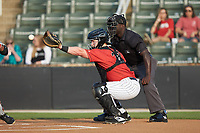 Kannapolis Intimidators catcher Gunnar Troutwine (37) receives a pitch as home plate umpire James Jean looks on during the game against the Delmarva Shorebirds at Kannapolis Intimidators Stadium on June 4, 2019 in Kannapolis, North Carolina. The Intimidators defeated the Shorebirds 9-0. (Brian Westerholt/Four Seam Images)