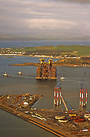 Jacket (sub-sea structure) and tanks for installation in North Sea oil field under tow from construction yard.. Scotland.  Aerial.