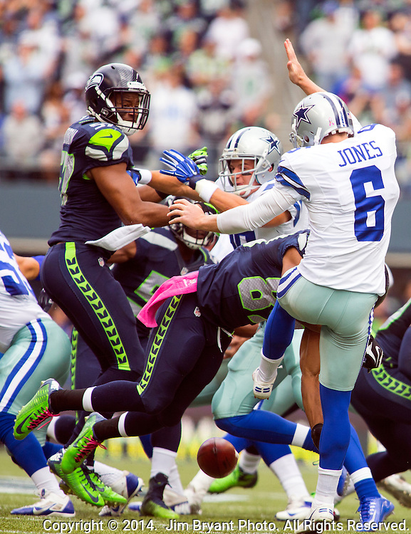 Seattle Seahawks wide receiver Doug Baldwin (89) blocks Dallas Cowboys punter Chris Jones (6)  punt in the first quarter that led to a Seahawks touchdown at CenturyLink Field in Seattle, Washington on October 12, 2014.   The Cowboys beat the Seahawks 30-23 .  ©2014. Jim Bryant Photo. All rights Reserved.