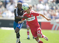 Gavin Clinton, left, holds off Gonzalo Segares, right, .Chicago Fire 1, San Jose Earthquakes 0, Saturday, April 12, 2008 at the Oakland Coliseum, Oakland, California.