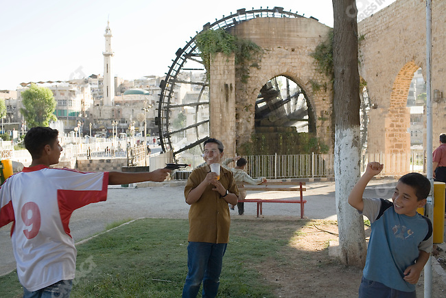 Playing around the famous water wheels of Hama, Syria.