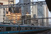 Shinbashi, the iconic place for Japanese businessman, aka salary man in Tokyo Japan.  Shinbashi station platform for Keihin Tohoku line.  Businessman (salarymen) are on board.