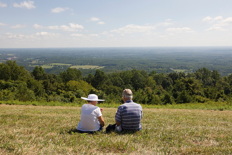 A couple enjoys lunch from Mt Altos overlooking the city of Charlottesville. Credit Image: © Andrew Shurtleff