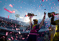Oct 16, 2016; Ennis, TX, USA; Confetti falls as NHRA top fuel driver Antron Brown celebrates after winning the Fall Nationals at Texas Motorplex. Mandatory Credit: Mark J. Rebilas-USA TODAY Sports