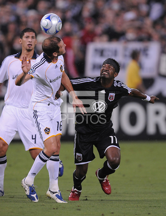 Los Angeles Galaxy defender Greg Berhalter (16) heads the ball against DC United forward Luciano Emilio (11) DC United tied with Los Angeles Galaxy 0-0 at RFK Stadium, Saturday August 22, 2009.