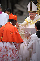 Cardinal Kelvin Edward Felix of Saint Lucia  receives his beret as he is being appointed cardinal by Pope Francis  at the consistory in the St. Peter's Basilica at the Vatican on February 22, 2014.