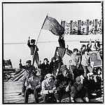 "Like Red Guards across the country, fishermen along the upper Songhua River on the outskirts of Harbin eagerly demonstrate their devotion to Mao, criticizing ""Liu Shaoq's revisionist line"" with a banner and portraits of Mao. Bayan county, Heilongjiang province, 8 July 1967"