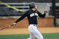 Jonathan Pryor (11) of the Wake Forest Demon Deacons follows through on his swing against the Towson Tigers at Wake Forest Baseball Park on March 1, 2015 in Winston-Salem, North Carolina.  The Demon Deacons defeated the Tigers 15-8.  (Brian Westerholt/Four Seam Images)
