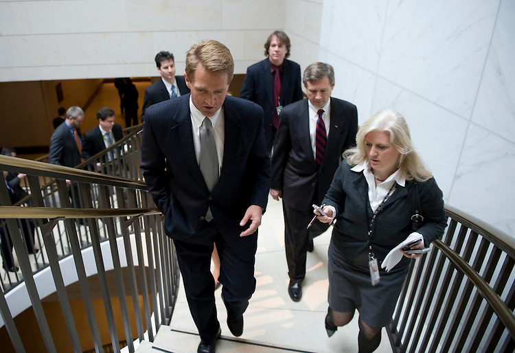 Jeff Flake, R-Ariz., is chased by reporters after the House Republican Conference in the CVC basement of the U.S. Capitol. March 11, 2010.