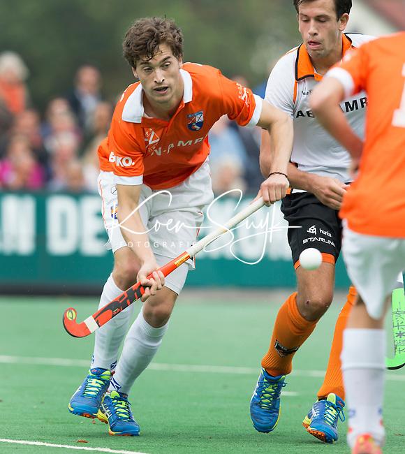 BLOEMENDAAL - Jord Beekmans van Bloemendaal  tijdens  de wedstrijd tussen de mannen van Bloemendaal en Oranje-Zwart (1-2). Copyright Koen Suyk