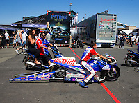 Jul. 26, 2014; Sonoma, CA, USA; Crew members push NHRA pro stock motorcycle rider Hector Arana Jr through the pits during qualifying for the Sonoma Nationals at Sonoma Raceway. Mandatory Credit: Mark J. Rebilas-