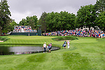 CROMWELL, CT. 21 June 2019-062119 - PGA Tour players Paul Casey, left, and Jason Day walk around the pond and up to the par 3 eighth hole surrounded by fans, during the second round of the Travelers Championship at the TPC River Highlands in Cromwell on Thursday. Bill Shettle Republican-American