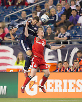 New England Revolution midfielder Chris Tierney (8) and Toronto FC defender Richard Eckersley (27) battle for head ball. In a Major League Soccer (MLS) match, the New England Revolution tied Toronto FC, 0-0, at Gillette Stadium on June 15, 2011.