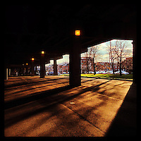 Sunlight streams into the shadows under I-95 in the Queen Village section of Philadelphia December 19, 2012.