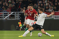 Dominik Szoboszlai (L) of Hungary and Sebastian Coates (R) of Uruguay fight for the ball during the inauguration match of the newly reconstructed Ferenc Puskas Stadium between Hungary and Uruguay in Budapest, Hungary on Nov. 15, 2019. ATTILA VOLGYI