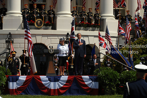 Washington, D.C. - May 7, 2007 -- United States President George W. Bush and first lady Laura Bush participate in a South Lawn Arrival Ceremony for Her Majesty Queen Elizabeth II and His Royal Highness The Prince Philip, Duke of Edinburgh of Great Britain on the South Lawn of the White House in Washington, D.C. on Monday, May 7, 2007.  .Credit: Ron Sachs / CNP