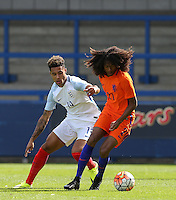 Tahiti Chong (Manchester United) of Holland holds off Andre Green (Aston Villa) of England U19 during the International match between England U19 and Netherlands U19 at New Bucks Head, Telford, England on 1 September 2016. Photo by Andy Rowland.