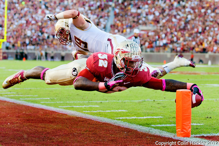TALLAHASSEE, FL 10/13/12 FSU-BC1013012 CH -Florida State's James Wilder, Jr. gets the ball around the pylon for a touchdown as Boston College's Sean Sylvia tries to stop him during first half action Saturday at Doak Campbell Stadium in Tallahassee. .COLIN HACKLEY PHOTO