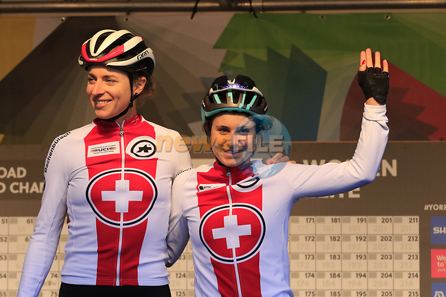 Elise Chabbey and Marlen Reusser of Switzerland at sign on for the start of the Women Elite Road Race of the UCI World Championships 2019 running 149.4km from Bradford to Harrogate, England. 28th September 2019.<br /> Picture: Eoin Clarke | Cyclefile<br /> <br /> All photos usage must carry mandatory copyright credit (© Cyclefile | Eoin Clarke)