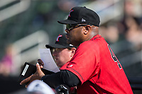Kannapolis Intimidators hitting coach Jamie Dismuke (45) watches from the dugout during the game against the Hagerstown Suns at Kannapolis Intimidators Stadium on June 14, 2017 in Kannapolis, North Carolina.  The Intimidators defeated the Suns 4-1 in game one of a double-header.  (Brian Westerholt/Four Seam Images)