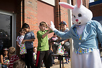 NWA Democrat-Gazette/CHARLIE KAIJO Dillon Nelson, 10, high-fives the Easter bunny during an Easter egg hunt, Friday, April 12, 2019 at the Boys and Girls Club in Rogers. <br /> <br /> The Mitchell Williams Law Firm gave the Boys and Girls club of Rogers a $15,000 grant and held an egg hunt for the kids of the club. They offer grants each year through a program called Take Time To Give. The purpose is to encourage the law staff to do charitable work said Kyle Heffley, an attorney from the firm. <br /> <br /> The Boys and Girls club has five facilities in the county serving 150-200 kids at each site. The clubs experience a lot of wear-and-tear. Contributions from community organizations help the staff to focus on serving the kids.