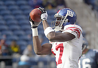 27 Nov 2005:  New York Giants wide receiver Plaxico Burress warmed up before the start of the game against the Seattle Seahawks at Qwest Field in Seattle, Washington.