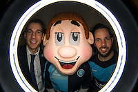 Matt Bloomfield (left) of Wycombe Wanderers & Sam Wood of Wycombe Wanderers pose with Bodger the Mascot during the Sky Bet League 2 match between Wycombe Wanderers and Crawley Town at Adams Park, High Wycombe, England on 28 December 2015. Photo by Andy Rowland / PRiME Media Images
