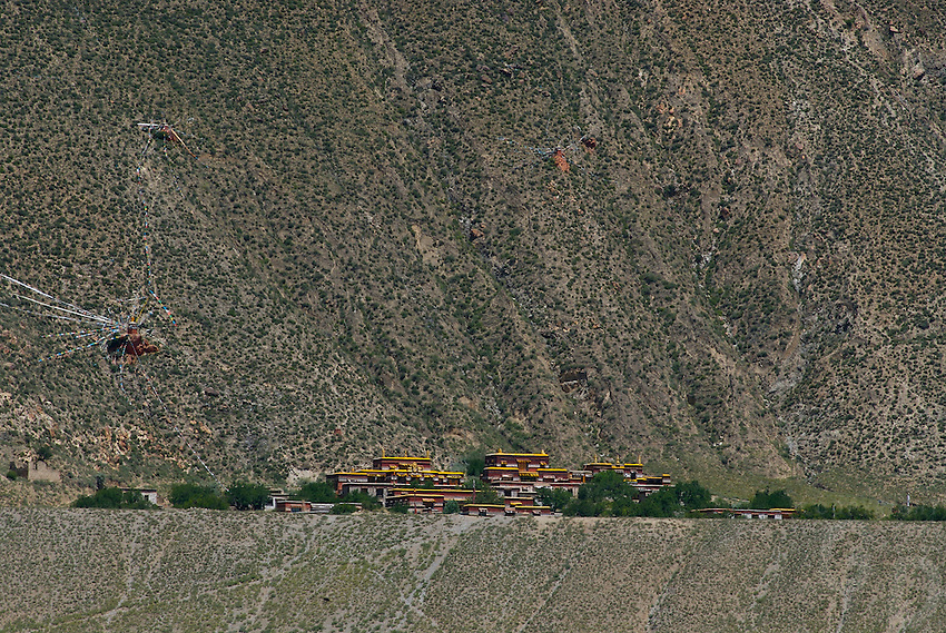A monestary high up is decorated with Tibetan Pryer flags on the way to Namtso Lake,Tibet