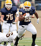 SIOUX FALLS, SD - NOVEMBER 16: CJ Ham #28 from Augustana looks for running room past JJ Bobrowicz #56 from Southwest Minnesota State in the second quarter of their game Saturday at Augustana. (Photo by Dave Eggen/Inertia)