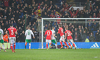 Simon Church of Wales celebrates scoring his side's equalising goal from the penalty spot during the International Friendly match between Wales and Northern Ireland at Cardiff City Stadium, Cardiff, Wales on 24 March 2016. Photo by Mark  Hawkins / PRiME Media Images.