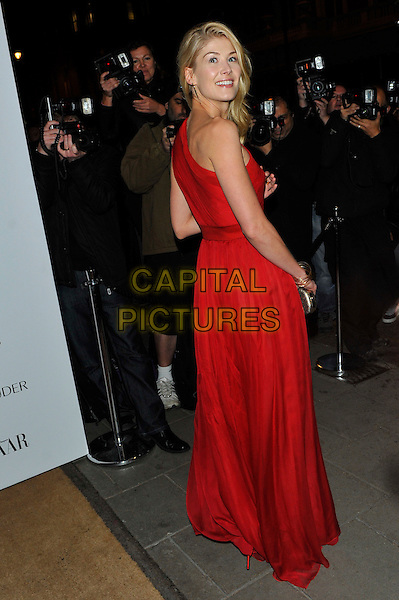 Rosamund Pike.Harper's Bazaar Woman of the Year Awards at Claridge's Hotel, London, England..October 31, 2012 .full length red one shoulder dress back behind rear looking over shoulder photographers press.CAP/CJ.©Chris Joseph/Capital Pictures.