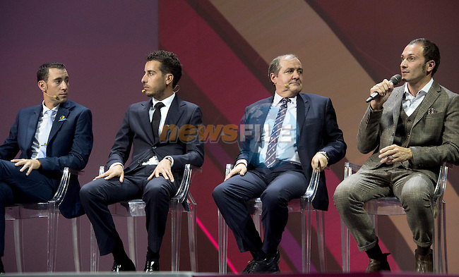 Defending Champion Vincenzo Nibali, Fabio Aru, Race Director Mauro Vegni and Ivan Basso on stage at the 100th edition Giro d`Italia 2017 route presentation held at the Ice Palace in Milan, 25th October 2016.<br /> Picture: ANSA/Claudio Peri | Newsfile<br /> <br /> <br /> All photos usage must carry mandatory copyright credit (&copy; Newsfile | ANSA/Claudio Peri)
