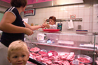 Upset boy in meat market on Lutomierska Street Balucki District Lodz Central Poland