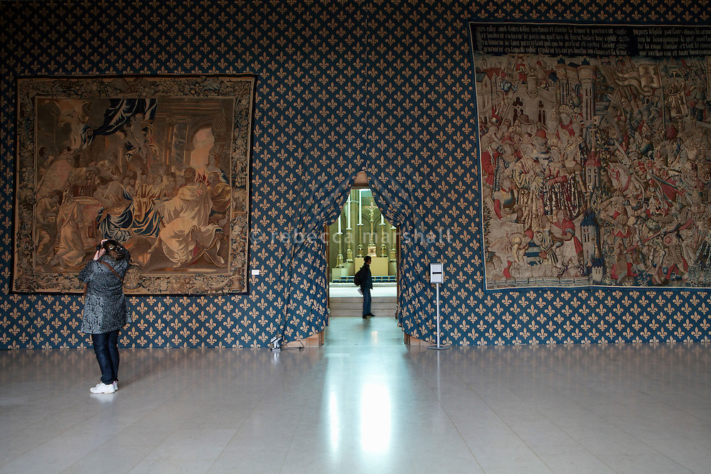 Tapestries depicting the life and baptism of Clovis (tapestry on the left dates from the17th century; the one on the right from the 15th century)  on the wall of the Tau Room in which coronation banquets were held, looking through the doorway to the upper chapel, at the Palais du Tau, Reims, France, 10 November 2015. The Palais du Tao adjoins the cathedral of Notre-Dame de Reims, which was the former residence of the archbishops and served as the royal palace during coronations.
