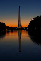 View of Washington Monument, Capitol Building and Reflecting Pool at Sunrise.