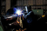 Workman welding at steel fabrication plant. Birmingham Alabama.