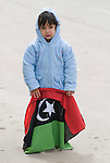 BENGHAZI, LIBYA..DEMONSTRATIONS CONTINUE TO URGE THE INTERNATIONAL COMMUNITY TO IMPOSE A NO FLY ZONE AND RECOGNIZE THE REVOLUTIONARY COUNCIL AS THE LEGITIMATE GOVERNMENT OF LIBYA..ASSIL SHABAN WHO WILL BE 3 NEXT WEEK WITH THE NEW FLAG OF LIBYA..11-3-2011 PIC BY IAN MCILGORM