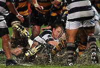 Auckland hooker Tom McCartney tackles Chris Walker. Air New Zealand Cup rugby match - Taranaki v Auckland at Yarrows Stadium, New Plymouth, New Zealand. Friday 9 October 2009. Photo: Dave Lintott / lintottphoto.co.nz
