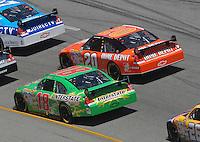 May 6, 2007; Richmond, VA, USA; Nascar Nextel Cup Series driver Tony Stewart (20) races alongside teammate J.J. Yeley (18) during the Jim Stewart 400 at Richmond International Raceway. Mandatory Credit: Mark J. Rebilas