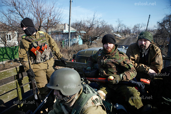 UKRAINE, 02.2016, Oblast Donetsk. Ukrainian-Russian conflict concerning Eastern Ukraine: Members of the far-right militia Pravyi Sektor fighting the Russian-backed separatists on their way to the frontline near Donetsk. © Timo Vogt/EST&OST