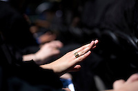 "A graduating student looks at her ""Brass Rat"" class ring during the 2012 MIT Commencement on June 8, 2012, in Cambridge, Massachusetts, USA...Photo by M. Scott Brauer"