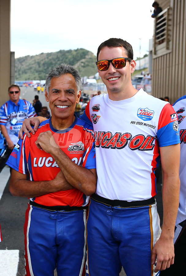 Jul. 19, 2013; Morrison, CO, USA: NHRA pro stock motorcycle rider Hector Arana Sr (left) with son Adam Arana during qualifying for the Mile High Nationals at Bandimere Speedway. Mandatory Credit: Mark J. Rebilas-