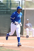 Christian Colon #4 of the Kansas City Royals runs to first base during a Minor League Spring Training Game against the San Diego Padres at the Kansas City Royals Spring Training Complex on March 26, 2014 in Surprise, Arizona. (Larry Goren/Four Seam Images)