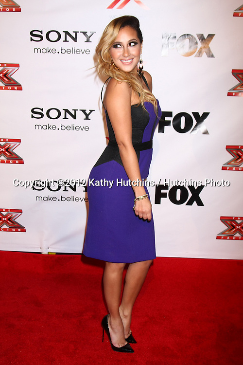 LOS ANGELES - DEC 6:  Adrienne Bailon arrives to the X Factor 2012 Final Four Party at Rodeo Drive on December 6, 2012 in Beverly Hills, CA